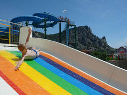 A water slide is just one of the activities you'll fine at an aqua fun park!
