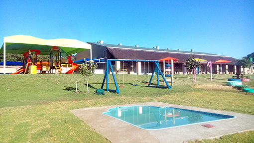 Splash pool and outdoor playground with jungle gym
