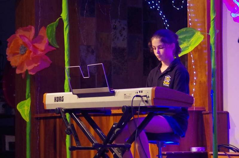 A piano student at th annual year end concert