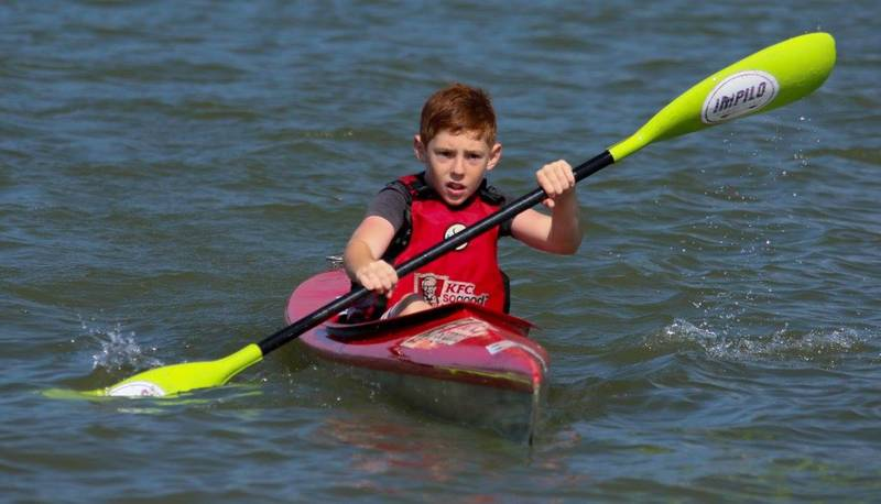 Active learn to paddle. Easton Scolnic on his way to his first race